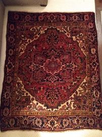 "Vitnage Persian Heriz, hand woven, 100% wool face, measures 4' 7"" x 5' 8""."