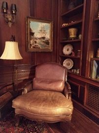 HERE is where you sit right down and nestle into a good book! Great leather armchair, with lumbar pillow. Nice, original oil painting of a ship, in a chippy ol' frame - it's jes rite!