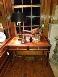 Vintage French leather-topped desk, with vintage Itlian tole lamp, French metal religious icon, one of a pair of 5-light brass and marble candleholders. Don't miss the purdy pheasant - if you shake some salt on his tail, he can be yours.                                                                                                   Salt = cash, in this instance...
