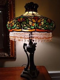 One of a pair of mee-maw, Tiifany style stained glass table lamps.
