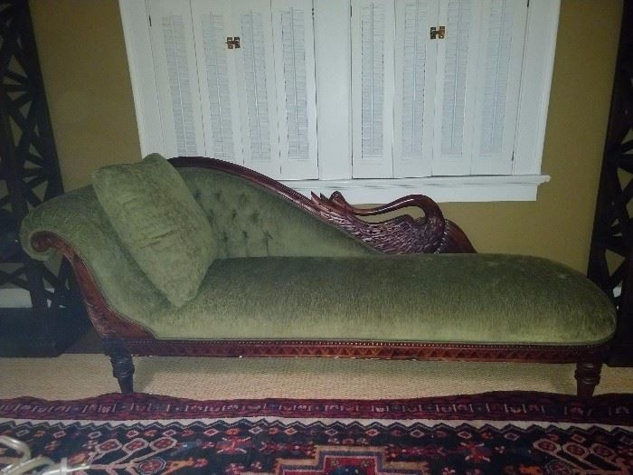 Unusual green upholstered vintage swan mahogany fainting couch. This is located in the upstairs office - perhaps a casting couch?                                                           Hmm, I'll nevah tell...