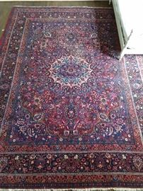 "Vintage hand woven Persian Kashan rug, 100% wool face, measures 10' 6"" x 13' 9""."