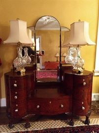 Antique burled wood dresser, with nicely carved ball and claw feet, glass pulls and triple beveled glass mirrors. Nice pair of cut crystal lamps, with sissy shades.