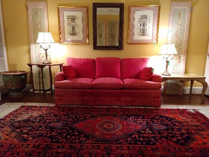 A quiet and restful upstairs sitting room, with hand painted door panels, red damask couch, Italian Florentine coffee table, pair of 4-light table lamps, large glazed ceramic urn, pair of nicely framed and matted architectural prints and a decent mirror.