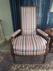 One of a pair of upholstered armchairs