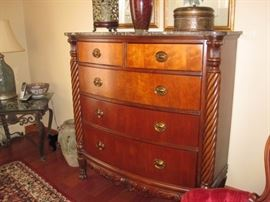 Beautiful curved front dresser with scroll work and carvings with marble top. $400
