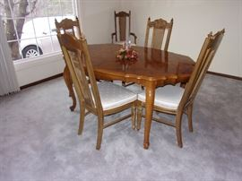 Dining room table and 6 chairs(two armed)
