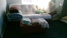 Futon, blankets, pillows, blanket chest