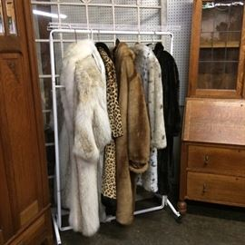 Beautiful collection of real fur coats including:   Leopard Fur Coat, Fox Fur Coat  by Jack Douglas, and a Mink Fur Coat by Russell Brown