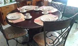 Table w/ 4 chairs...Wood, Wrought iron and padded seats