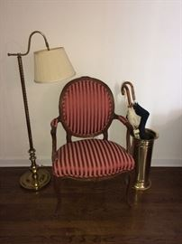 Brass: lamp, umbrella stand, fireplace set. A pair of these striped chairs available.