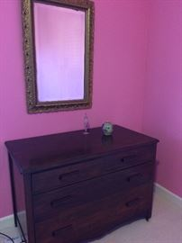 Antique mirror and beautiful antique dresser.