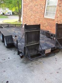 Large utility trailer.  Rated for car cargo.