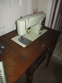 Singer sewing machine. One of three remaining.