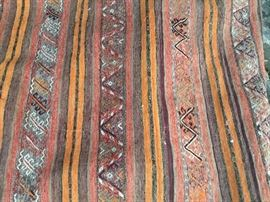 Long hand stiched and hand knotted rug $450