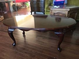 #7 qa leg oval coffee table wood 46x27x17 $100.00