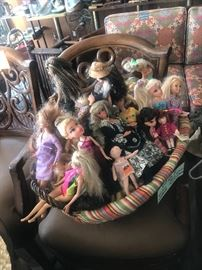 Basket of Barbie dolls and other dolls