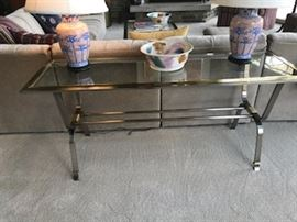 Contemporary glass and metal console table with Ted Keller Pottery bowl