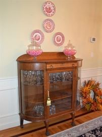 Oak curio cabinet with bowed glass