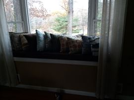 Various pillows and window seat cushions