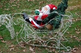 You know you want him....he's so chute.....Big Yard Art Santa & Sleigh