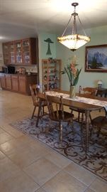 Dinette set table and 4 chairs, wool rug, shelves, Native American decorative pieces, Framed art