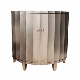 Contemporary Painted Demilune Cabinet: A contemporary silver painted demilune cabinet featuring a sharply scalloped semi-circled top over a complaint, fluted case fitted with silver painted wood knobs. The doors open to a black painted interior with a shelf. The case rests on four curved and tapered legs.