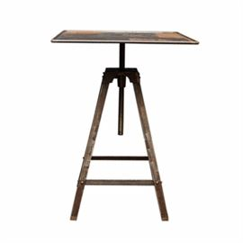 Industrial Style Accent Table: An Industrial style accent table. This table features a square top over a rotating pedestal that rises above splayed metal legs connected by a box stretcher. The piece is unmarked.