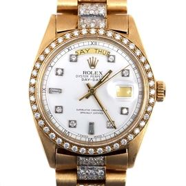 Rolex Oyster Perpetual Day-Date 18K Yellow Gold 4.37 CTW Diamond Wristwatch: A Rolex Oyster Perpetual Day-Date 18K yellow gold wristwatch with a diamond dial, date and day of the week windows, with a diamond bezel and diamond center links. The combined weight of all diamonds is 4.37 ctw.