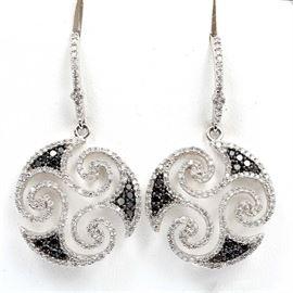 14K White Gold Swirled Diamond and Black Diamond Dangle Earrings: A pair of 14K white gold swirled dangle earrings adorned with diamonds and black diamonds.