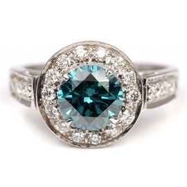 18K White Gold 1.55 CT Irradiated Blue Diamond Halo Ring: An 18K white gold 1.55 ct irradiated blue diamond and diamond halo ring.