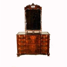 Vintage Northern Furniture Company Dresser with Mirror: A Chippendale style mahogany dresser by Northern Furniture Company, Sheboygan, WI. featuring a mahogany floral carved framed mirror. The rectangular dresser features four drawers, all fitted with brass plated batwing bail hardware and escutcheons.