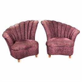 Vintage Art Deco Style Channel-Back Upholstered Chairs: A set of vintage Art Deco style channel-back upholstered chairs. This pair of chairs features a fan back with vertical tufting over a cushion seat and deep apron rising on round feet. The chairs are upholstered in a purple hue fabric. There are no visible maker's marks.