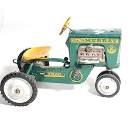 """""""Diesel Murray"""" Riding Tractor: A Diesel Murray riding tractor with a yellow seat, pedals and steering wheel."""