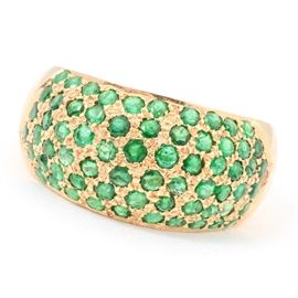 18K Yellow Gold Emerald Ring: An 18K yellow gold emerald ring.