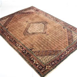 """Vintage Hand-Knotted Persian Senneh Bijar Rug: A vintage hand-knotted Persian senneh bijar rug. This rug features a sepia colored field with an all over floral lattice in shades of peach, green, blue, and tan. At the center is a single green, peach, and tan diamond medallion with a crenelated edge and there are four coordinating corner spandrels at each corner. The main border features a geometric pattern in shades of tan, navy, green, and peach against a charcoal colored field. There is natural warp fringe to either end and it is marked to the reverse """"Made In Iran Hand Woven""""."""