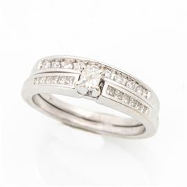 14K White Gold Diamond Wedding Ring Set: A 14K white gold diamond wedding ring set.