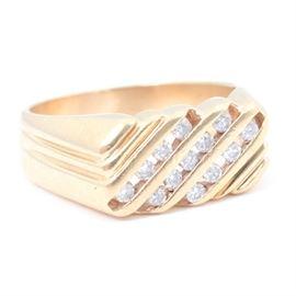 14K Yellow Gold Diamond Ring: A 14K yellow gold diamond ring.