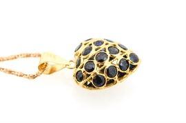 18K Yellow Gold Sapphire Heart Necklace: An 18K yellow gold sapphire heart necklace.