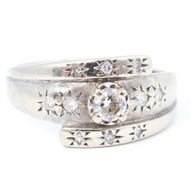 14K White Gold Diamond Ring: A 14K white gold diamond ring.
