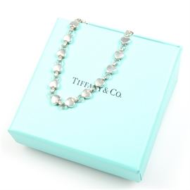 Tiffany & Co. Sterling Silver Heart Bracelet: A Tiffany & Co. sterling silver heart bracelet. This bracelet features several links, all shaped like hearts.