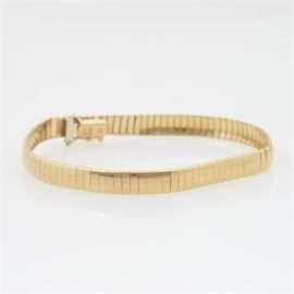 14K Yellow Gold Omega Bracelet: A 14K yellow gold omega bracelet.