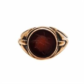 10K Yellow Gold Black Onyx Intaglio Ring: A 10K yellow gold black onyx intaglio ring. This ring features decorative shoulders and a bezel set concave black onyx with the image of an Roman warrior done in intaglio style.