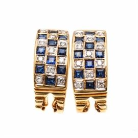 18K Yellow Gold Diamond and Sapphire Earrings: A pair of 18K yellow gold diamond and sapphire earrings. Each earring features eleven round brilliant cut diamonds and ten sapphires set in a checkerboard pattern. These earrings are convertible, and can be worn with the post or as clip-ons with their omega clip backs.