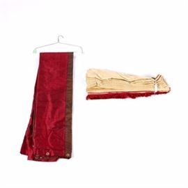Decorator's Drapery Panel and Roman Shade: A drapery panel and matching Roman shade. The panel is made from raw silk in scarlet with mocha trim; it has white fabric lining, and gromets for hanging. The drapery comes with a Roman shade made of cream-colored fabric with jacquard garlands and scarlet fringe and trim. The pieces are unmarked.