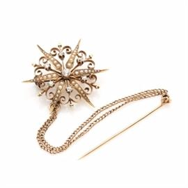 Antique 14K Yellow Gold Diamond and Pearl Starburst Pendant Brooch: An Antique 14K yellow gold diamond and pearl starburst pendant brooch. This late Victorian era piece features a decorative starburst brooch attached to a short gold filled chain and straight pin.