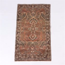 "Hand-Knotted Persian Arak Area Rug: A hand-knotted Persian Arak area rug. This wool rug features a Sarouk-style design in an abrashed palette of cinnamon, taupe, cream, and camel, with prominent celadon, black, and cerulean highlights. It has a purposefully abrashed cinnamon field seeded with a round flowerhead at the center, the field populated with chains and sprays of flowers. Framing the field are three borders, including a main border grounded in dark taupe and filled with alternating floral clusters and flowerheads. Selvedges are overcast, the rug finishing at each end with tan cotton warp fringe. It is labeled ""Made in Iran"" on the reverse."