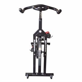 "Schwinn Spinner Pro Exercise Bike: A Schwinn Spinner Pro exercise bike. This black stationary bicycle has a weighted flywheel. The machine is marked ""Schwinn"", ""Spinner Pro"" and ""Made in Taiwan""."