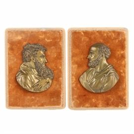Metal Relief Portraits of Men: A pair of metal relief portraits of men. Each piece depicts a bearded figure in profile, a peaceful expression on his face. They have no maker's marks and are mounted on orange velvet-covered panels with rings for hanging.