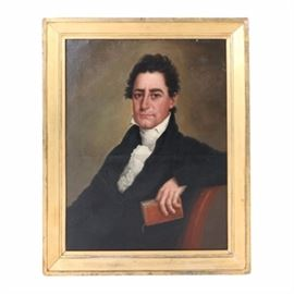 Oil Portrait Painting on Canvas of a Man: An oil portrait painting on canvas of a man. This unsigned painting depicts a gentleman in a black and white suit seated in a chair clutching a book. The painting is presented in a gold tone gesso and wood frame. A wire is present to the verso for hanging purposes.